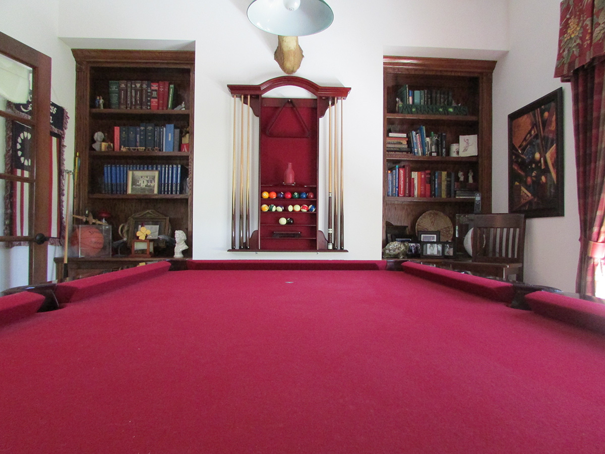 Pool table inside colonial style home